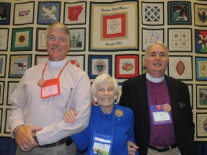 Betty is pictured with the Rev. Eric Turner and Bishop Gregory O. Brewer.