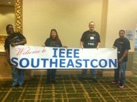 Valencia College students at IEEE conference sporting the winning t-shirt design.