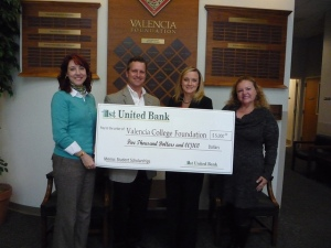 1st United Bank presents a check for $5,000 to Valencia Foundation for student scholarships at Valencia College.  From left to right: Michelle Matis, COO, Valencia Foundation; Sam Miles, Sr. VP, 1st United Bank; Jennifer Hinkle, Business Development Officer, 1st United Bank; Donna Marino, CFRE Valencia Foundation Manager