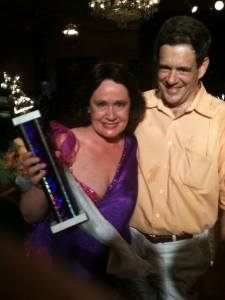 Dean Maguire and her husband, Raymer III, with her First Place trophy.